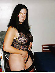 Horny black haired in black underwear touching her pussy.