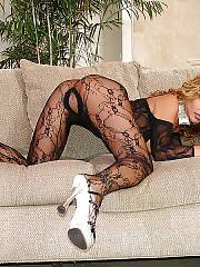 Hot curly blond MILF wanking her pussy.