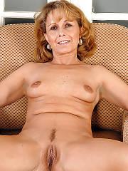 Hot blondie mature woman pleasuring herself on sofa