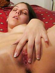 Sexy dark haired stroking and touching her wet pink pussy.