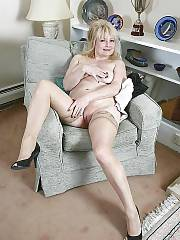 Blond mature mamma undresses at home