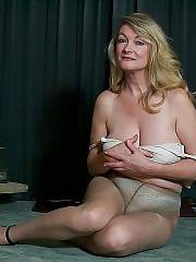 Hot boobed blondie mamma undresses on the floor.