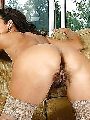 Nasty latin mature woman playing with her unshaved vagina on couch