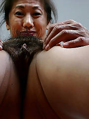 Sexy asian hairy MILF positions naked.
