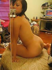 Sexy oriental babe enjoys naked selfshot.