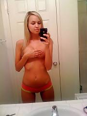 Sexy blondie teen enjoys selfshooting herself naked infront of the mirror.