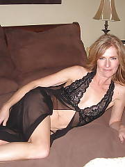 MILF wifey in underwear poses in bed.