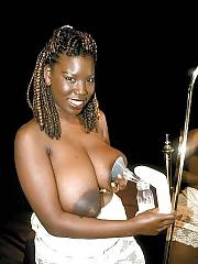 Boobed mature ebony mamma loves milking her massive titties.
