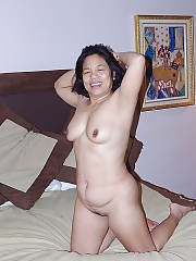 Asian mature jin showing and spreading her sloppy pussy.