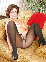 Mother in black pantyhose undresses
