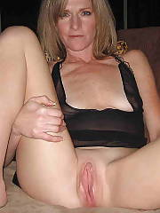 Horny mature wife spreading and wanking her sloppy snatch.