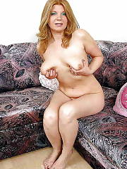 Blondie mature on couch massaging her crotch.