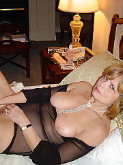 Russian baby stips and toying her sloppy snatch on bed.