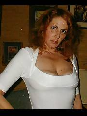 Mature red-haired wifey exposes her cool hooters and twat