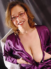 Mamma in sweet purple suit having joy with her titties and pussy.