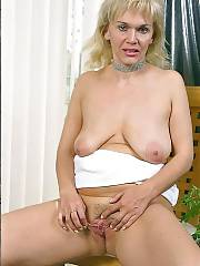 Blond horny mamma showing boobs and wanking pussy.