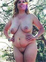 Mature busty blondie MILF gets nude outdoor in the woods.