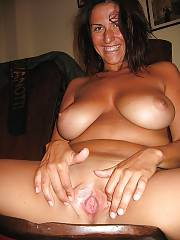 Nasty  black haired mother jerking and toying herself.