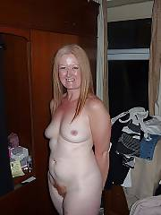Blondie mamma with red unshaved cunt positions nude on cam.