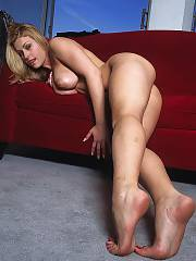 Hot blond mom positions naked on the couch.
