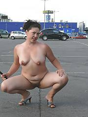My bitch posing in public, she does whatever i tell her since her hubby and my father died