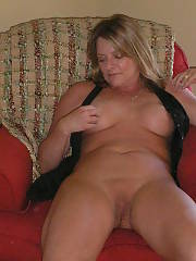Lazy nudist MILF exposing her titties and twat while relaxing
