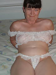 My old lady in her white lingerie.  she was known in high school as the bleacher suck queen
