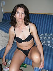 Sexy mom in her underwear flashing and playing with her pussy.