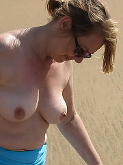 My mother showing off her body on the beach, shes not super fit but not super bbw either