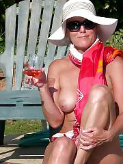 Mature woman gettin naked in the pool