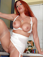 British redhead mature fondling her wet cunt in the kitchen.