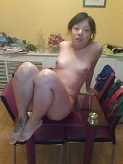 Naughty oriental MILF rubbing her clit.