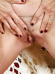 Boobed mature slut showing her boobs and pussy.