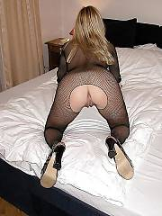 Sexy light haired wifey in fishnet exposing her excellent body