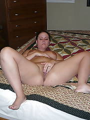 Nasty wife spreads her legs and toying her wet pussy.