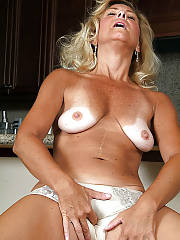 Horny blonde mature lady enjoys playing with her nasty panty.