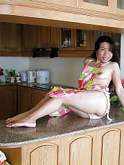 Hairy twat MILF in the kitchen.