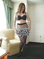 MILF in pantyhose spreading and exposing her pussy.