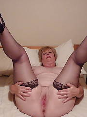 Horny chubby mature mom exposing her wet pussy.