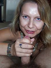 Naughty mature MILF sandy sucking cock.