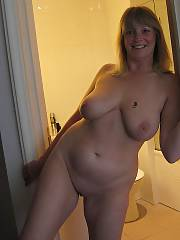 Sexy mature sue toying her wet cunt at home.
