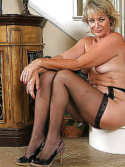 Sexy blonde mature in stockings teasing at home