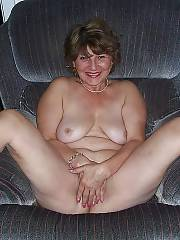 Grandma with fine body gets naked at home and massages her clit.