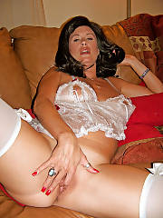 Dark haired mom in sexy underwear jerking her vagina on couch