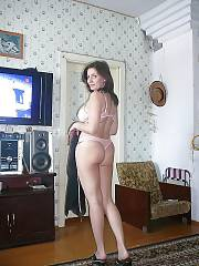 My MILF stripteasing at home.