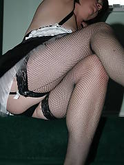 Hot mature maid wearing fishnet.