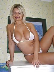 Blond MILF in bikini exposes her sexy body.