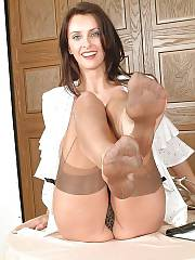 Sexy mature brunette in pantyhose teasing herself.