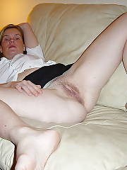 Hot light haired mature wife masturbating her wet pussy.