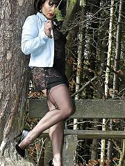 Mature mom amanda wearing stockings in th woods
